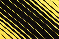 Striped black and yellow textile pattern as a background. Stock Photography