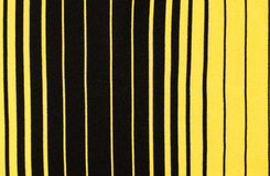 Striped black and yellow textile pattern as a background. Royalty Free Stock Images