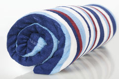 Striped blanket twisted to roll Stock Images
