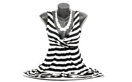 Striped blouse on mannequin with matching accessories. Black and white blouse on tailor's dummy Royalty Free Stock Image