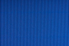 Striped blue embossed paper. Colored paper. Livid texture background. Royalty Free Stock Images