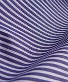 Striped blue fabric background. Piece of a striped blue textile. Good for background Royalty Free Stock Photography