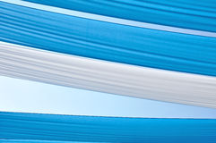 Striped blue shade. Between white pattern Stock Image