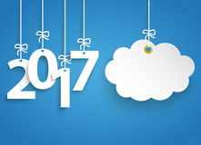 Striped Blue Sky 2017 Cloud Sticker. Hanging numbers 2017 and cloud sticker on the blue striped background Royalty Free Stock Images