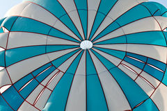 Striped blue with a white parachute Stock Image