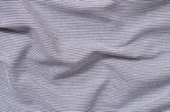 Striped blue and white textile pattern as a background. Royalty Free Stock Images