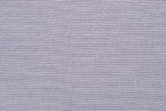 Striped blue and white textile pattern as a background. Royalty Free Stock Photo