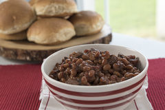 Striped Bowl of Baked Beans on Red With Buns Stock Photos