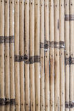 Striped brown bamboo wood wall Stock Image