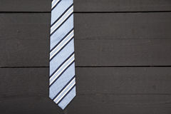 Striped business tie on wooden background Royalty Free Stock Photo