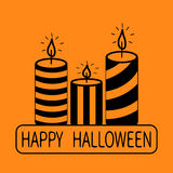 Striped candle set. Happy Halloween text. Greeting card. Flat design. Orange background. Stock Images