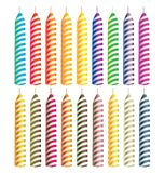 Striped candles. Striped bright color candles isolated on a white background Royalty Free Stock Photo