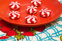Striped candy on red saucer Stock Image