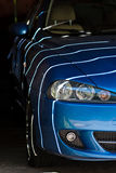 Striped car from the sun. Striped blue car from the sun royalty free stock image