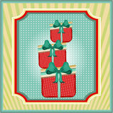 Striped card with dotted, red gifts with blue bow Stock Photos