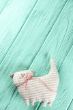 Striped cat on a wooden background Royalty Free Stock Image