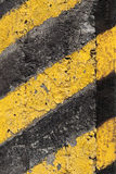Striped caution pattern on old concrete wall Royalty Free Stock Photos
