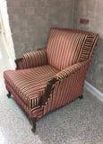 Striped Chair Against Brick Wall Stock Photos