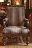Striped chair. Front seats upholstered with a striped fabric with armrests and carved legs Royalty Free Stock Photo