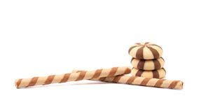 Striped chocolate wafer rolls and stake biscuits. Royalty Free Stock Image
