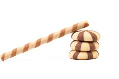 Striped chocolate wafer rolls and stake biscuits. Stock Photos