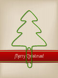 Striped christmas greeting with tree shaped paper clip Stock Images