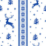 Striped Christmas pattern. Seamless striped Christmas pattern knitted reindeer, trees and snowflakes Scandinavian style Stock Photography