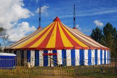 Striped circus tent. White red blue yellow Stock Photography