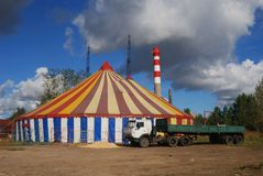 Striped circus tent. White red blue yellow Royalty Free Stock Photo