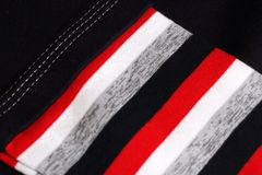 Striped cloth with red, black, grey, beige and white colors. Background Royalty Free Stock Photo