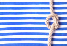 Striped cloth and a rope Stock Images