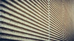 Striped concrete wall of a bridge Royalty Free Stock Photos