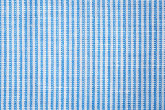 Striped cotton closeup. Blue striped cotton closeup ,shirts fabric texture background Royalty Free Stock Photography