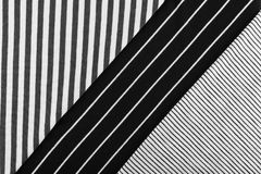 Striped Cotton Fabric Background. Diagonal Striped Cotton Fabric Background. Black and White Textile Pattern. Soft and Comfortable Natural Material Royalty Free Stock Photography