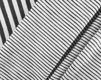 Striped Cotton Fabric Background. Diagonal Striped Cotton Fabric Background. Black and White Textile Pattern. Soft and Comfortable Natural Material Royalty Free Stock Image