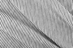 Striped Cotton Fabric Background. Diagonal Striped Cotton Fabric Background. Black and White Textile Pattern. Soft and Comfortable Natural Material Royalty Free Stock Images