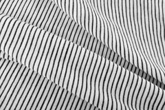 Striped Cotton Fabric Background. Diagonal Striped Cotton Fabric Background. Black and White Textile Pattern. Soft and Comfortable Natural Material Royalty Free Stock Photo