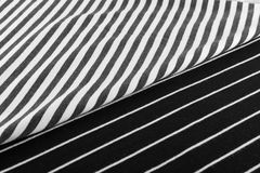 Striped Cotton Fabric Background. Diagonal Striped Cotton Fabric Background. Black and White Textile Pattern. Soft and Comfortable Natural Material Stock Photography