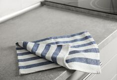 Free Striped Cotton Towel On Countertop Royalty Free Stock Image - 183305226