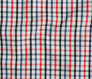 Striped crumpled tablecloth. Stock Image