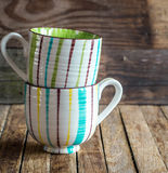The striped Cup on wooden background Stock Image