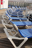 Striped deck chairs. Blue and white striped deck chairs on a deck of a cruise ship Stock Photography