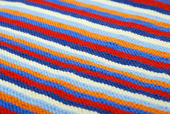 Striped diagonal background of knitted cloth. Royalty Free Stock Photos