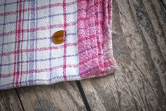 Striped dish cloth on brown wood royalty free stock image