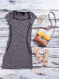Striped dress with dark sunglasses. Royalty Free Stock Images
