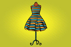 Striped dress in Studio on the dummy front hanger. Comic cartoon style pop art vector retro illustration Royalty Free Stock Images
