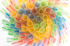 Striped drinking straws creating a swirl on a white background Royalty Free Stock Photos
