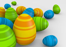 Striped Easter eggs. Group of rendered 3D striped Easter eggs in different sizes Royalty Free Stock Images