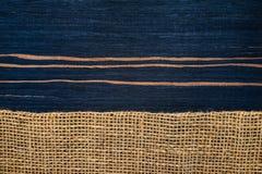 Striped ebony wood texture with hessian Royalty Free Stock Image