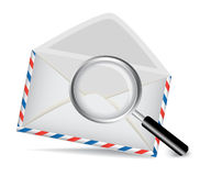 Striped envelope and magnifying glass Royalty Free Stock Photography